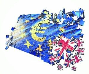 Brexit image of Union Jack breaking away from the EU blue flag with yellow stars
