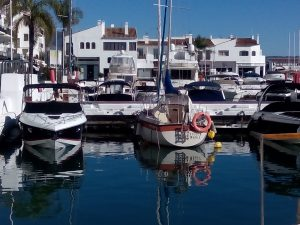 Sunny marina surrounded with property in the Costa Del Sol