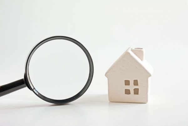 Little Model House with Large Black Magnifying Glass