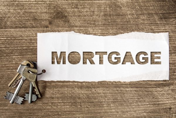 Mortgage spelled on paper with house keys to the side