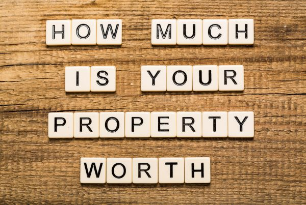 Sign asking How Much is your Property Worth?